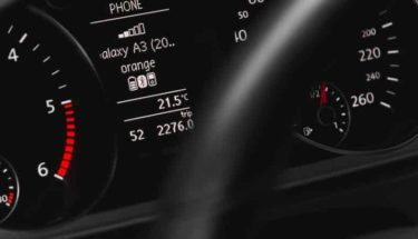 A car dashboard with many light symbols