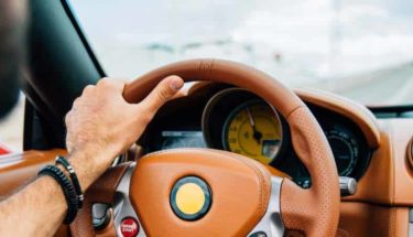 Dashboard view of a man driving a car