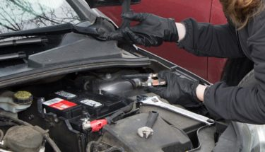 woman checking car battery