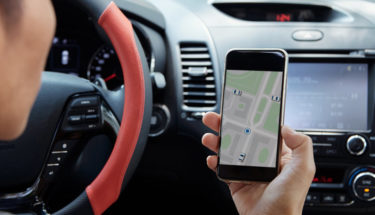 female driving while using smart phone