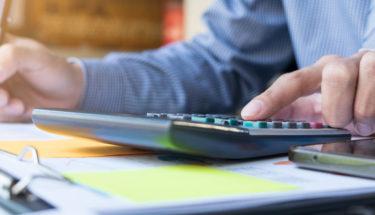 business finance man calculating