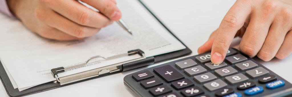 close-up businessman calculating expenses