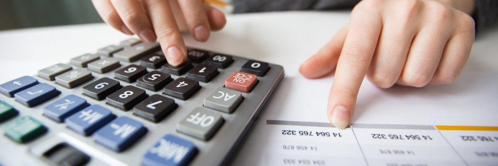 closeup accountant hands calculator