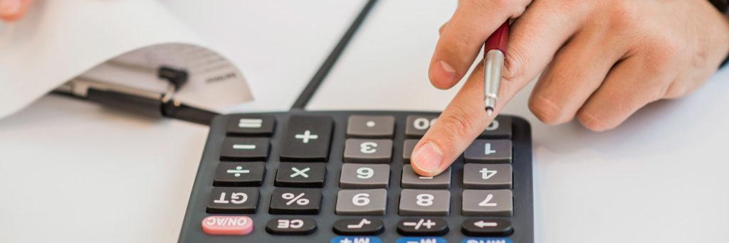 Close-up of businessman calculating